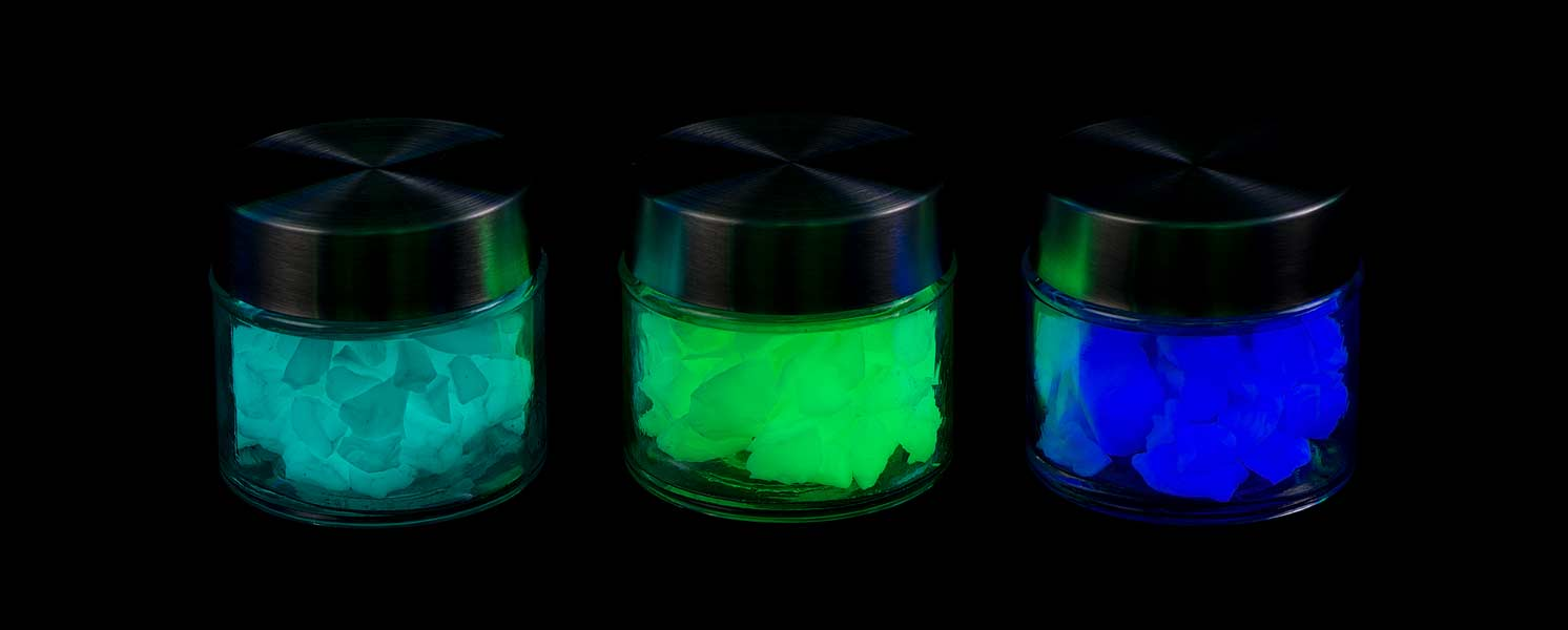 Jars of colour pigment glowing